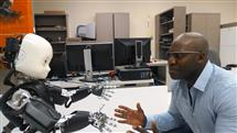 Osuagwu at the Language Acquisition and Robotics Lab with the iCub humanoid robot. Photo credit: Junia Findlay, ECE ILLINOIS.