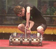 Ryan Shulski, captain of the Combots division of iRobotics, prepares 'Proton Shaker' for combat.