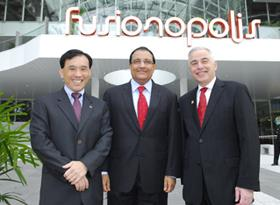 A*Star Chairman Lim Chuan Poh (left), Senior Minister of State for Trade and Industry S. Iswaran, and Illinois Chancellor Richard Herman stand outside the Fusionopolis building in Singapore after the February 12 opening ceremony for the Advanced Digital Sciences Center.