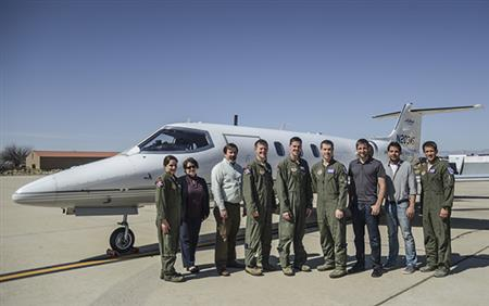 "The L1 controller testing team (l-r) Captain Margaret ""Sass"" Blackstun, Naira Hovakimyan, Christopher Cotting, Captain Timothy ""Speed"" Lau, Captain Robert ""Spike"" Jeffrey, Captain Shawn ""Demon"" Stephens, Kasey Ackerman, Enric Xargay, Captain Paul ""Rush"" Fulkerson."