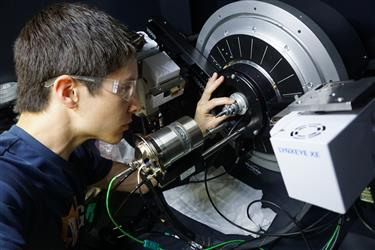 Shoemaker prepares a sample for in-situ x-ray diffraction in the Materials Research Laboratory.