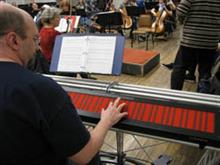 Mark Smart performs on the Continuum Fingerboard during a recent rehearsal of the Champaign-Urbana Symphony Orchestra.