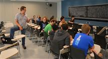 Professor Scott Carney teaches ECE 398 on the methods of the engineering process.