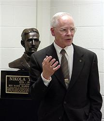 Retired Michigan school teacher John Wagner talks with the audience after unveiling the bust of Nikola Tesla in 167 Everitt Lab on September 10, 2002. Wagner's third and fourth grade students have donated 10 busts of Tesla to major universities. The inscription reads,