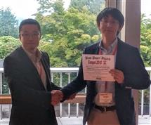 Shibin Qin accepting the best paper award at the COMPEL conference.