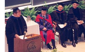 Dr. Brand Fortner speaking at the investiture of Frederick K. Lamb as the Brand and Monica Fortner Endowed Chair in Theoretical Astrophysics. From left, Dr. Fortner, Professor Lamb, Professor Miles V. Klein, Chancellor (then Provost) Richard Herman.