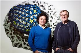 U. of I. physics professor Klaus Schulten, right, postdoctoral researcher Juan Perilla and their colleagues used experimental data and computer simulations to determine how a human protein that aids HIV infection binds to the HIV capsid.