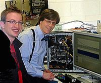 ECE graduate student Michael Wayne (left) and Physics Professor Paul G. Kwiat at work in Kwiat's lab. Photo by R. Hohenstein.