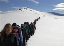 The class crosses Larsbreen Glacier on Svalbard, Norway, during the first course originating from a new partnership between the U of I and universities in Sweden. (Photo by Mark Safstrom)