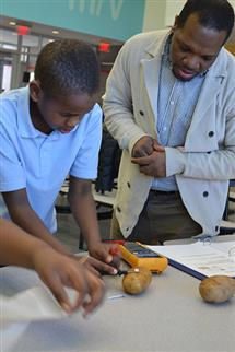 Jerrod Henderson works with a student at the St. Elmo Brady STEM Academy, an organization he co-founded. It's one of the main reasons Henderson received the 2014-2015 Campus Award for Excellence in Public Engagement.