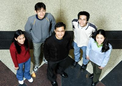ECE students Cac Nguyen, Quang Nguyen, Chinh La, and Hien Nguyen surround ECE Professor Minh Do.