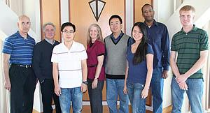 Members of the new Center for Nanostructured Electronic Materials (from left): ECE Professor Joseph Lyding; Gregory Girolami, professor of Chemistry; Wei Ye, graduate student, Materials Science and Engineering; Lisa McElwee-White (principal investigator), University of Florida; David Wei, University of Florida; Noel Chang, graduate student, Chemistry; Marcus Lay, University of Georgia; Justin Mallek, graduate student, Chemistry.