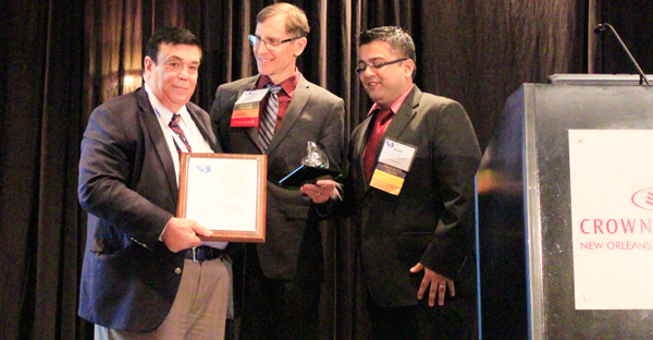 Reis in New Orleans with Dr. Gary Georgeson and Dr. Anish Poudel receiving the American Society for Nondestructive Testing's 2016 Research Award for Sustained Excellence and the Outstanding Paper Award