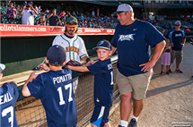 Casey Fletcher greets kids at a recent Joliet Slammers game (Photo courtesy of Joliet Slammers.)