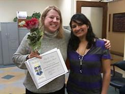 ECE Lecturer and chief undergraduate advisor Marie-Christine Brunet (left) was presented the Amy L. Devine Award by Sonam Patel of Alpha Omega Epsilon engineering sorority.