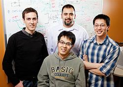 Led by electrical and computer engineering professor Eric Pop, left, a team of researchers have developed a form of ultra-low-power digital memory that is faster and uses 100 times less energy than similar available memory. Team members: back row, from middle, David Estrada and Albert Liao; front, Feng Xiong. Photo by L. Brian Stauffer.