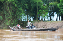 Rivers are an essential conduit for travel - even by motorbike - and commerce within the Mekong River basin. (Photo courtesy of Jim Best.)