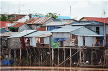 Resilience to flooding is engrained in Cambodian life and infrastructure, such as building houses on stilts to cope with rising water levels during the annual floods. This new study shows the significant role of tropical cyclones in driving sediment transport in the Mekong River, and how future trends in the tracks of cyclones may affect sediment flux to the Mekong delta. (Photo courtesy of Jim Best.)