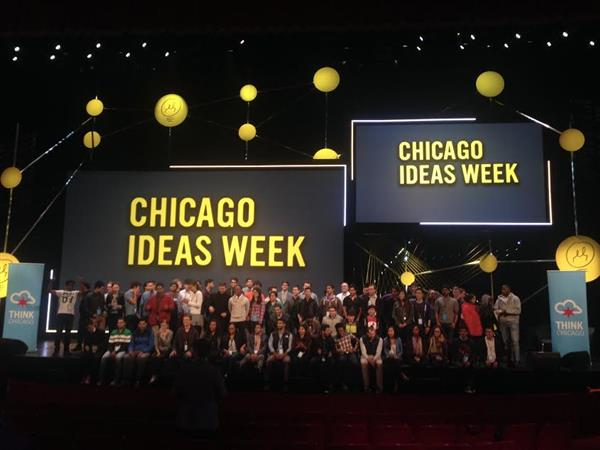 Students gather on Chicago Ideas Week stage for a group photo.