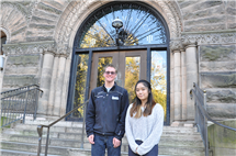 Lucas Trojanowski and Clara Yam pose in front of Altgeld Hall. They are among several high-achieving mathematics students who received reconfigured scholarships under a new program at the Department of Mathematics.