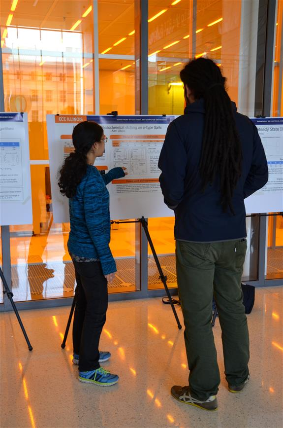 ECE graduate student Aditi Udupa demonstrates the 'Defect-revealing Photochemical Etching on n-type GaAs' through her poster.