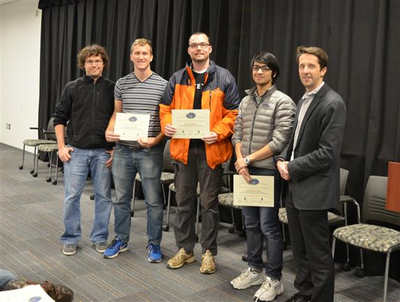The Lextech Senior Design Most Marketable Project Award was presented to Team 13 for their 'Closed-loop Temperature Controlled Lava Globe.' Team members: Daniel Frei, Devin Bryant, and Matthew Romano. Also pictured: James Norton (TA) and Professor Makela.