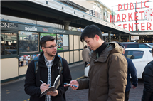 As an interaction designer at Expedia, Nixon (left) conducts usability studies with passersby in Seattle's Pike Place Market. (Photos courtesy of Chris Nixon.)