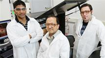 Rashid Bashir (center), a Bliss Professor of electrical and computer engineering and of bioengineering, led the researchers who developed a new solid-state nanopore sensor. He is flanked by graduate students Murali Venkatesan (left) and Sukru Yemenicioglu. Photo by L. Brian Stauffer.