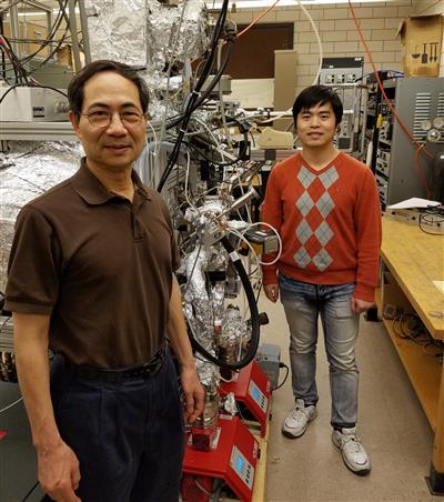 Physics Professor Tai-Chang Chiang and graduate student Caizhi Xu pose in Chang's laboratory at the Frederick Seitz Materials Research Lab at the University of Illinois at Urbana-Champaign. Image courtesy of Physics Illinois.