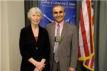 Emad Tajkhorshid, J. Woodland Hastings Endowed Chair in Biochemistry, poses with Tamara T. Mitchell, who, with her late husband, George W. Mitchell III, created the position through a gift to the university.