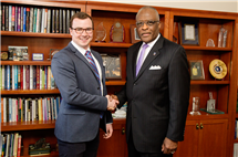 Thomas Dowling, left, a junior at the University of Illinois, congratulated by Chancellor Robert Jones. A Chicago native, Dowling was selected from a nationwide pool of nominees as one of 62 Truman Scholars.