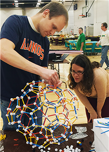 Illinois Geometry Lab volunteers create materials for outreach work. (Photo courtesy of the Department of Mathematics.)