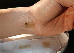An ultrathin, electronic patch with the mechanics of skin, applied to the wrist for EMG and other measurements. Photo courtesy John Rogers.
