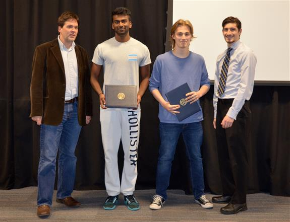 The Michelle and Alex Bratton Senior Design Instructor's award is presented to Vikram Mudaliar and Jesse Cornman for their 'Portable Multi-Channel Electrotactile Haptic Feedback System.' Also pictured: Professor Oelze, John Capozzo (TA).