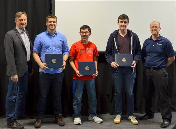 The Lextech Senior Design Award for Best Engineerd Project is given to Michael Genovese, Nicholas Denardo and Timothy Wong for their 'American Alphabet Sign Language Interpreter.' Also pictured: Professor Hutchinson, Jacob Bryan (TA).