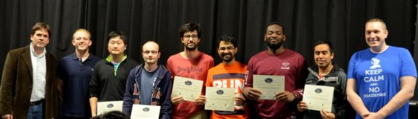 The Area Award for Teamwork and Collaboration is presented to two teams. Alejandro Otero, Changkun Li, and Theodore Culbertson for their 'Multistage Coil Gun Part 2,' and Adwaita Dani, Bryan Mbanefo, and Felipe Fregoso for their 'Coil Gun Control System and User Interface.' Also pictured: Professor Oelze, Jackson Lenz (TA), Luke Wendt (TA).