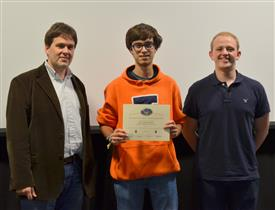 The Area Award for Power is awarded to Anshil Bhansali, Brain Slavin and Jose Montes for their 'Inductive Charging Case.' Also pictured: Professor Oelze, Jackson Lenz (TA).