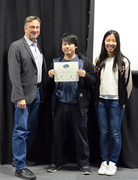 The Area Award for Ergonomics is presented to Jie Jia, Yifei Li and Zhengfeng Wu for their 'Omnimouse: Piezoelectric Sensor Mouse.' Also pictured: Professor Hutchinson, Kexin Hui (TA).