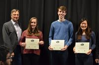 The Area Award for Entertainment was awarded to Emily Alessio, John Ryan, and Quinn Lertratanakul for their 'SATELLITE: Speed Adjusting, Track Exploring, Load Locating, Intelligent Train Engine.' Also pictured : Professor Hutchinson.