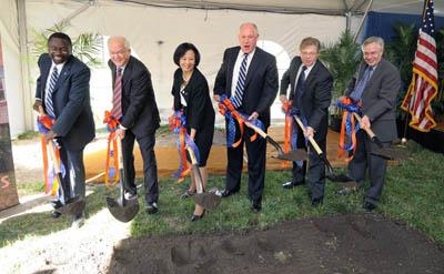 The groundbreaking ceremony ended with the assembled dignitaries digging into the site for the new ECE building. From left: College of Engineering Dean Ilesanmi Adesida, University of Illinois President Michael Hogan, Chancellor Phyllis Wise, Illinois Governor Pat Quinn, ECE Department Head Andreas Cangellaris, and ECE Professor Philip Krein, who is chair of the ECE Building Committee.