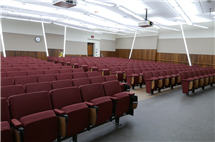 The NHB Auditorium is a large lecture hall that will seat 350 students, and there are plenty of allusions to geology all around for those who examine it closely. The painted stripes, wood paneling, and LED lighting design on the walls is meant to emulate the layers of the earth's crust.