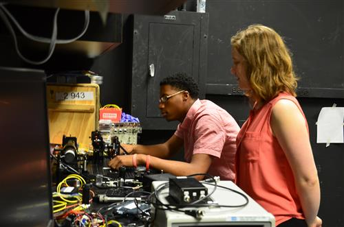 Young Scholar Davon Minor and his mentor Courtney Krafczyk  work in Professor Paul Kwiat's lab.