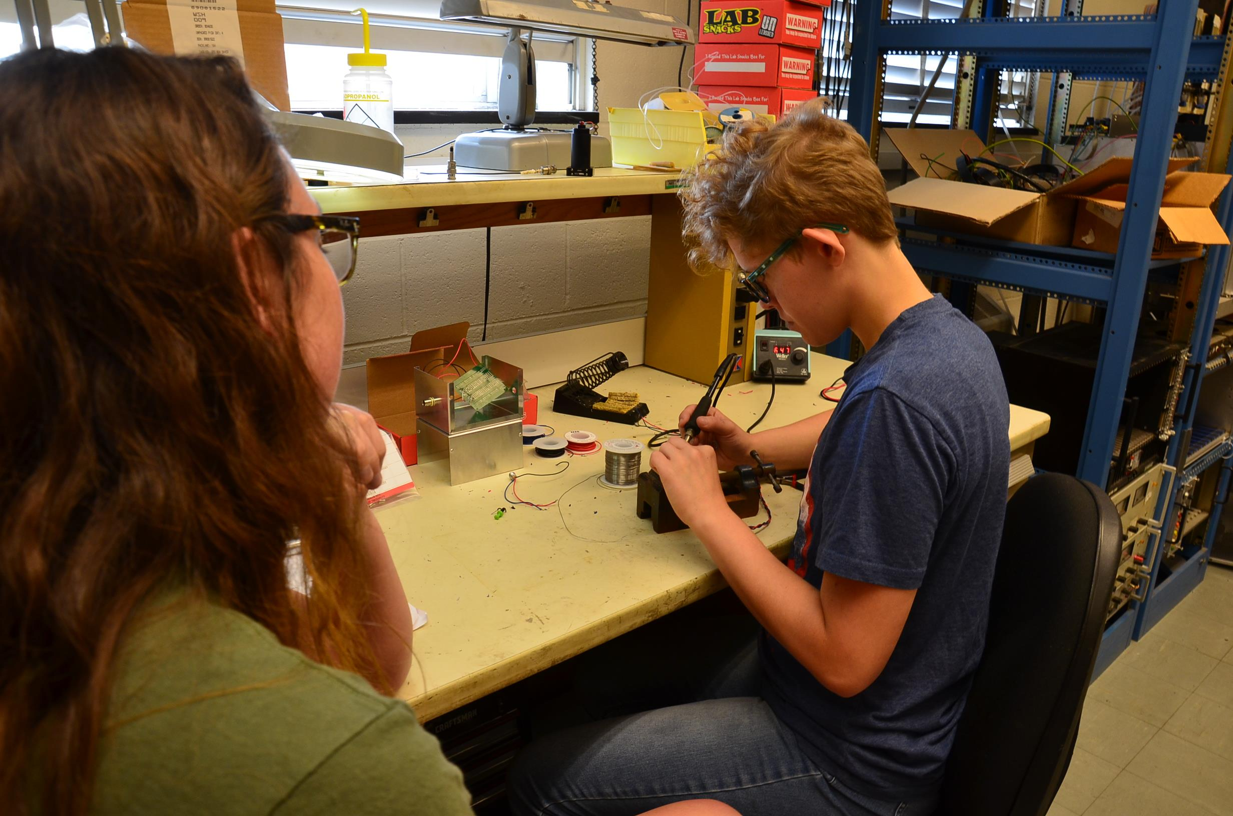 Jai Rice (right) at work with his lead mentor, Sidney Lower in Professor Doug Beck's lab. Rice worked on developing the nEDM experiment magnetometers.