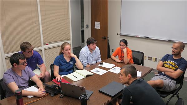 Leading members of CAPSat meet to discuss their progress. From left to right, Oguzhan Altun, Joe Stahl, Dawn Haken, Tiago Silva, Yukti Kathuria, Patrick Haddox, Vedant, and present by phone, McKale Berg.