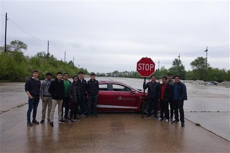 Autonomous Vehicles in AI (CS 598) was taken by 35 students. One group programmed a car to detect the distance to a stop sign from a video inside the vehicle then stop it in the right place.