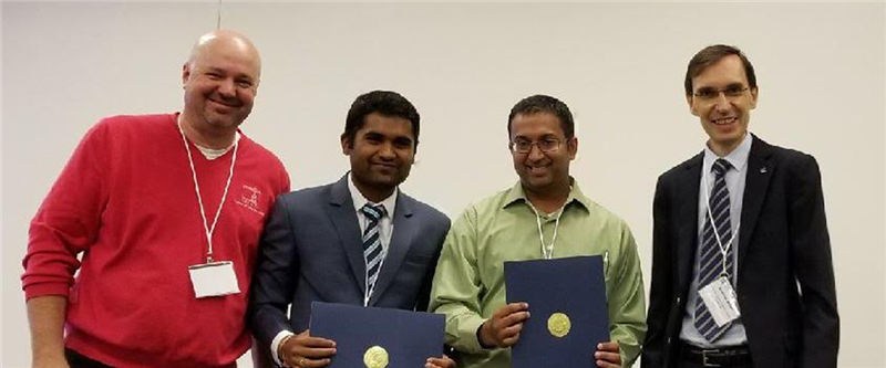 Krishnan and Patiballa as they receive their award. From left to right: Andrew P. Murray, conference session organizer, Sreekalyan Patiballa, Girish Krishnan, and Andreas Mueller, chair of 41th Mechanisms and Robotics Conference.