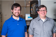 Kyle Grim, left, and Thomas Kiehl-Fie studyed how bacteria compete for zinc in the human body. (Image courtesy of the School of Molecular and Cellular Biology.)