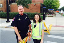 Jeff Christensen and Kasey Karlin, then a member of the Student Patrol, help manage football game traffic. (Photo courtesy of Jeff Christensen.)