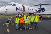 Illinois professor Bob Rauber, far right, University of Oklahoma (and former U of I) professor Greg McFarquhar, third from left, along with students from both universities, pause for a photo in Hobart, Tasmania, an Australian state. From there they studied clouds via a research airplane from the National Center for Atmospheric Research and National Science Foundation. (Image courtesy of Bob Rauber.)