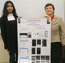 Anjali Sridhar (left) and Computer Science Proessor Klara Nahrstedt hold the poster they also presented at the 2011 EdMedia conference on their Mi-Clicker project.